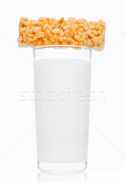 Glass of fresh breakfast milk with cereal bar Stock photo © DenisMArt