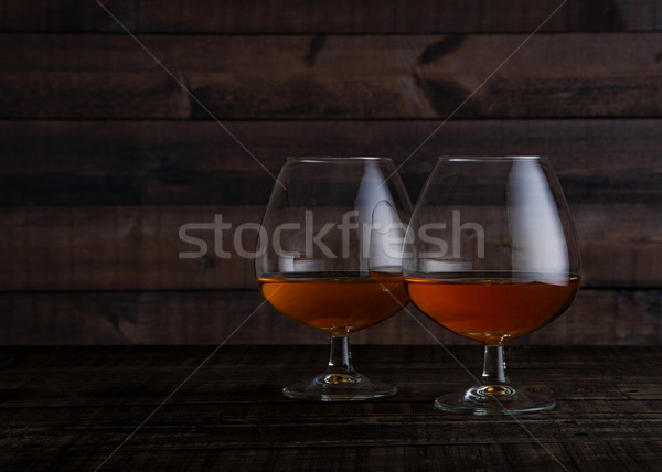 Verres brandy cognac coup table en bois bois Photo stock © DenisMArt