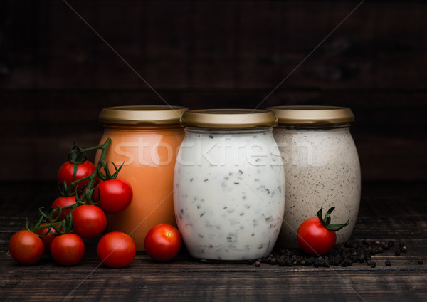 Glass jars of pepper tomato and potato sauce Stock photo © DenisMArt