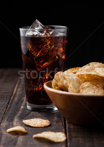 Crispy pepper crisps in wooden bowl with cola soda Stock photo © DenisMArt