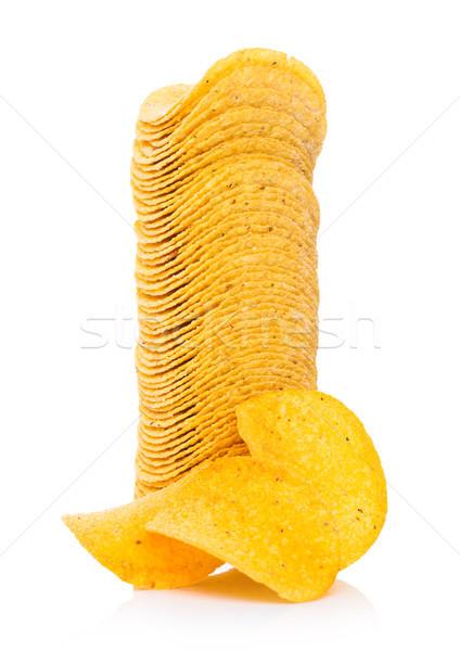 Round crispy potato crisps chips on white Stock photo © DenisMArt