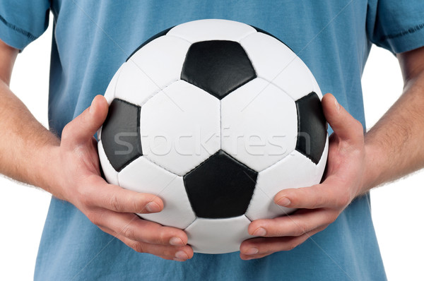 Man with classic soccer ball Stock photo © DenisNata