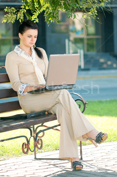 Business woman in summer park Stock photo © DenisNata