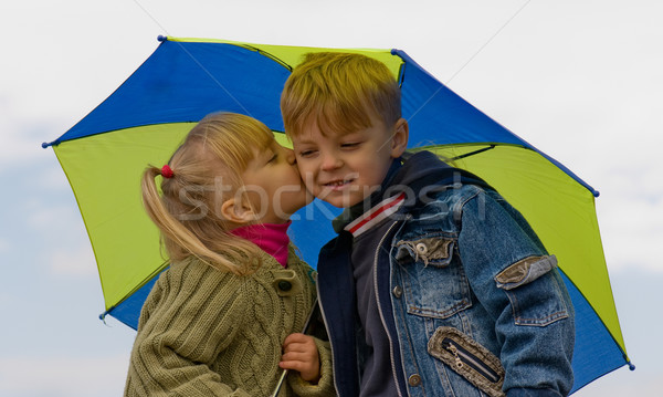 Little boy and girl with umbrella Stock photo © DenisNata