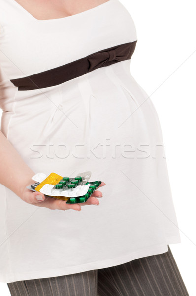 Pregnant belly with pills Stock photo © DenisNata