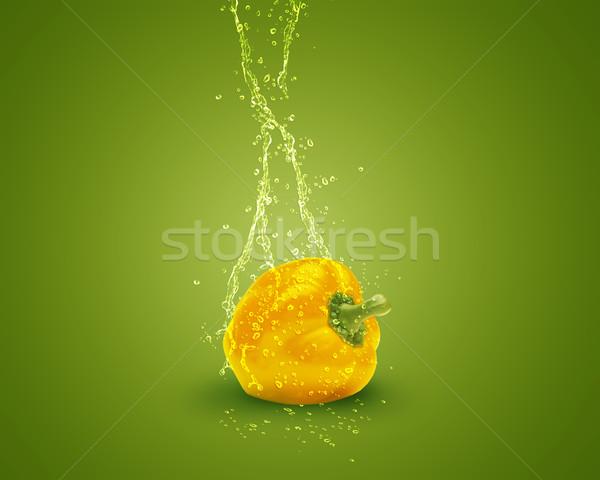 Friss citromsárga paprika víz csobbanások zöld Stock fotó © designsstock
