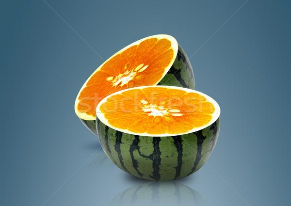 Water melon and Orange inside Stock photo © designsstock