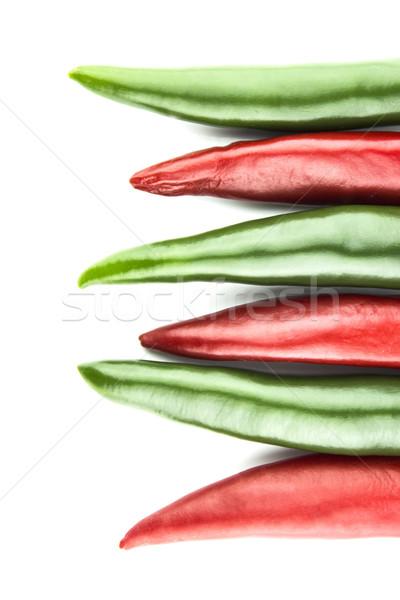 Forró chilipaprika piros zöld fehér háttér Stock fotó © designsstock