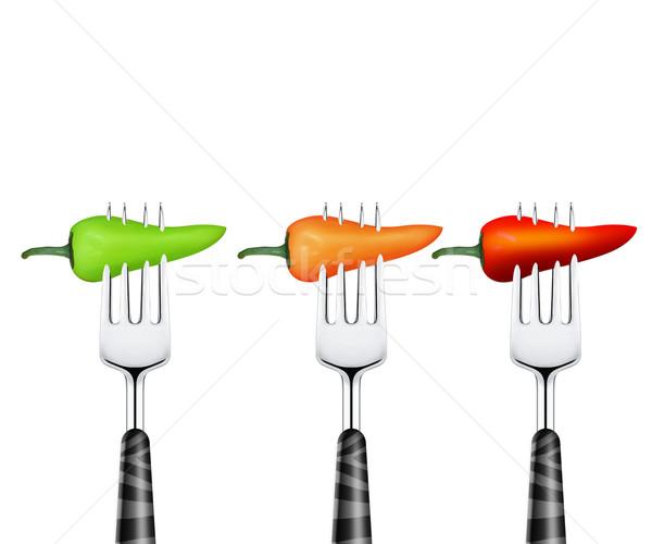 Chili pierced by fork Stock photo © designsstock