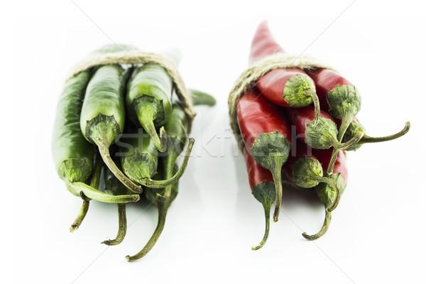 Forró chilipaprika kettő piros zöld fehér Stock fotó © designsstock