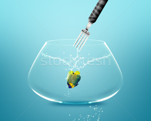 Stock photo: Fork catch angelfish in fishbowl