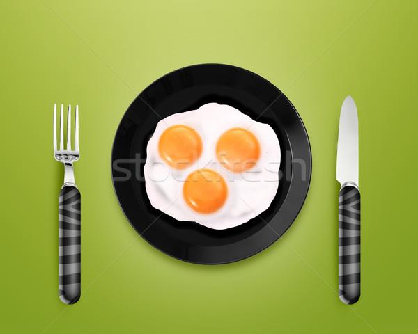 Három sült tojások tányér felső kilátás Stock fotó © designsstock