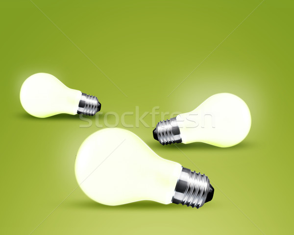 Three glowing Light bulb idea on green background Stock photo © designsstock