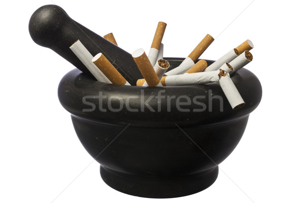 Quit smoking - pestle with cigarettes isolated over white Stock photo © devulderj