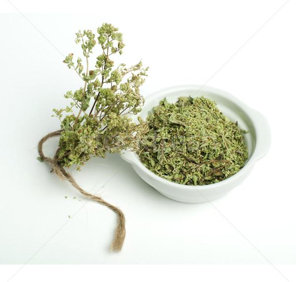 Dried oregano in a bowl and oragano twigs Stock photo © deyangeorgiev