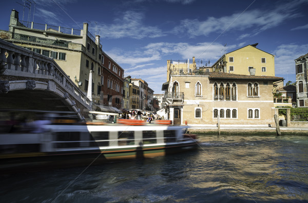 Ancient buildings and boats in the channel in Venice Stock photo © deyangeorgiev