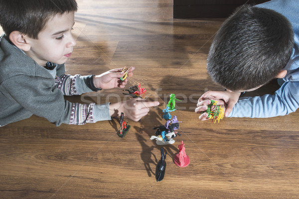Childs playing with small toys Stock photo © deyangeorgiev