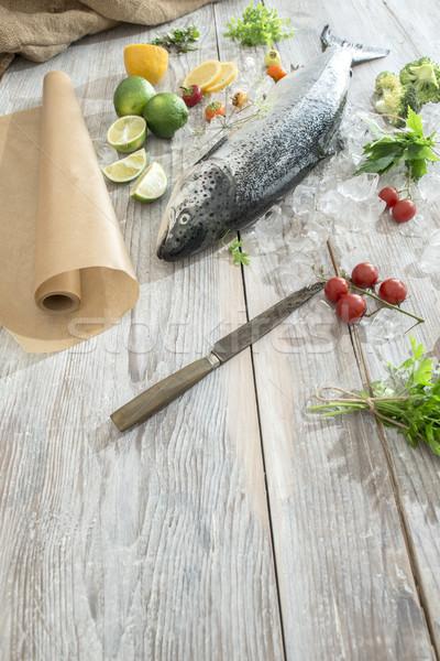 Raw salmon fish in ice and vegetables Stock photo © deyangeorgiev