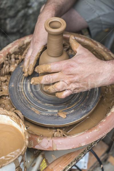 Potter makes clay bottle Stock photo © deyangeorgiev