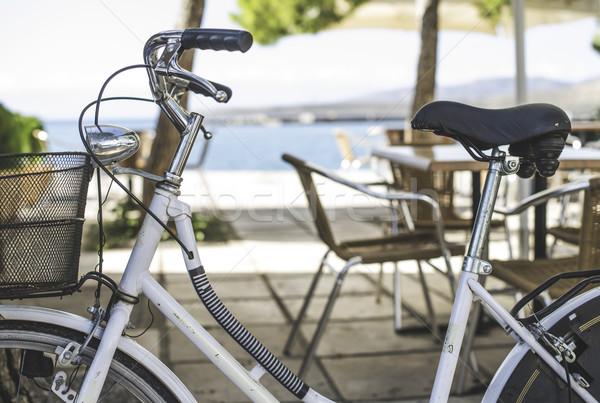 Vintage white bicycle. Stock photo © deyangeorgiev