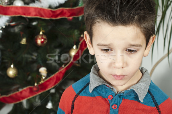 Unhappy little boy on christmass Stock photo © deyangeorgiev