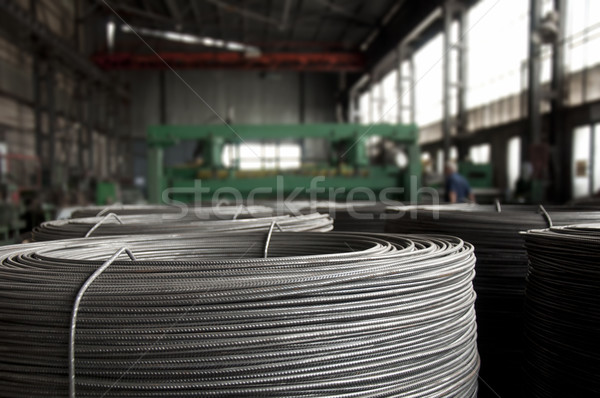 Stock photo: Reinforcing steel bars on roll.