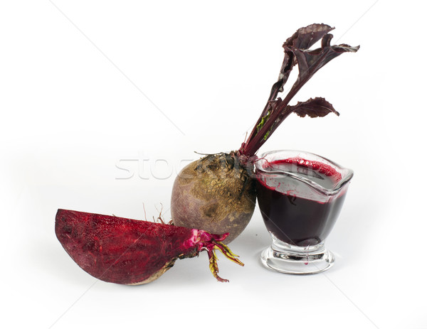 Red beets with leaves, slice beets and jug with juice Stock photo © deyangeorgiev