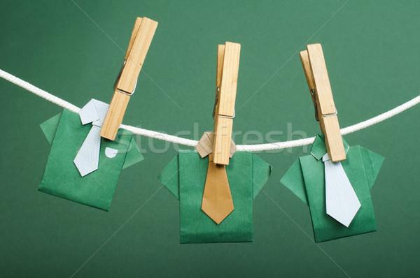Origami shirts on rope Stock photo © deyangeorgiev