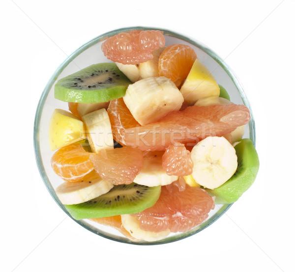 Fruit salad with citrus in a glass bowl Stock photo © deyangeorgiev