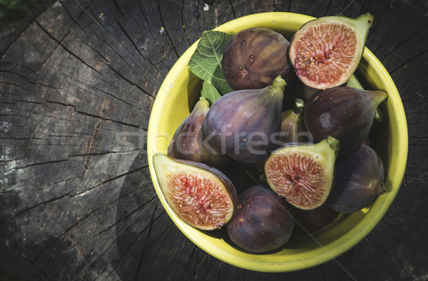 Figs in bowl on wood Stock photo © deyangeorgiev