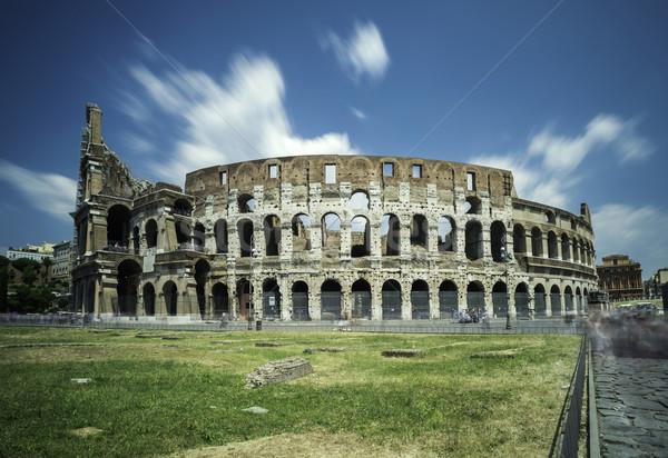 Colosseum Roma yeşil ot çim mavi seyahat Stok fotoğraf © deyangeorgiev