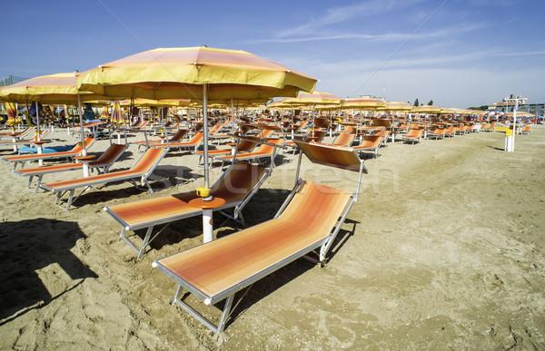 Parapluies plage orange eau soleil mer Photo stock © deyangeorgiev