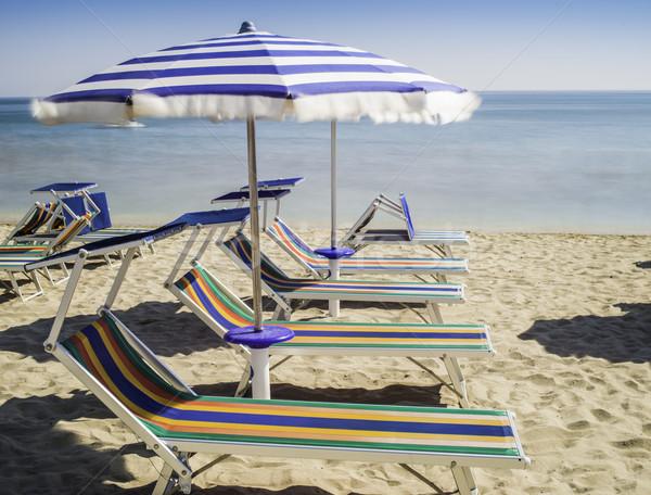 Parapluies plage eau soleil mer bleu Photo stock © deyangeorgiev