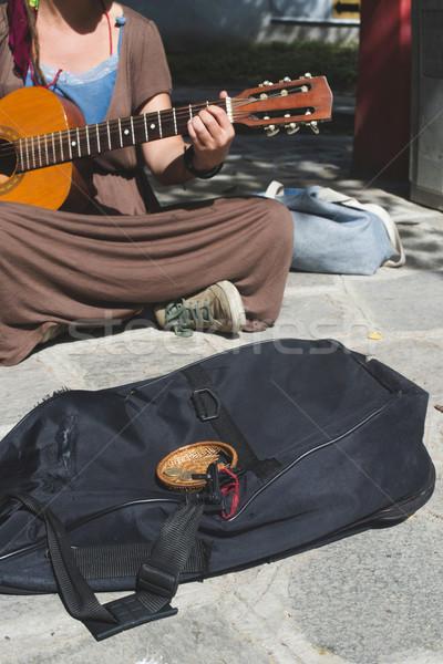 Girl playing guitar on the street Stock photo © deyangeorgiev