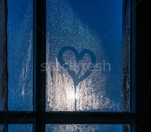 Moonlight through the window. Sweaty glass and heart Stock photo © deyangeorgiev
