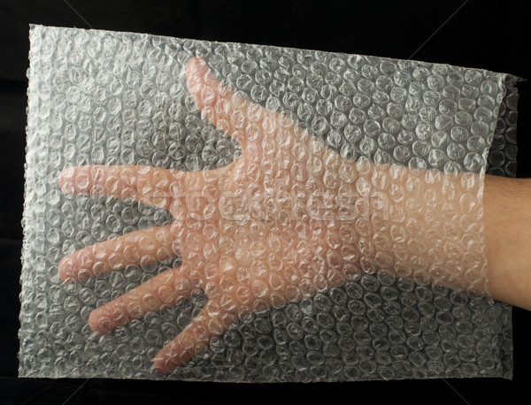 Plastic bag and hand inside Stock photo © deyangeorgiev