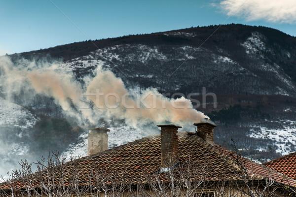 Chimney of the house and smoke Stock photo © deyangeorgiev