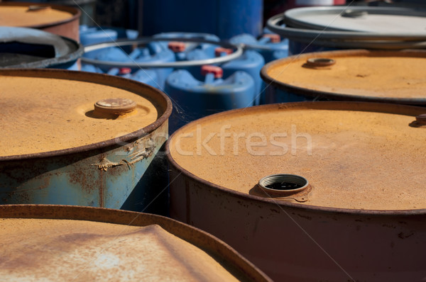 Stock photo: Old colored barrels for oil products