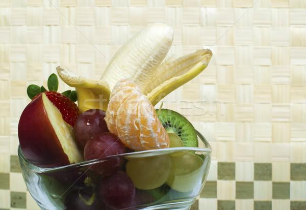 Fruit salad in a glass bowl Stock photo © deyangeorgiev