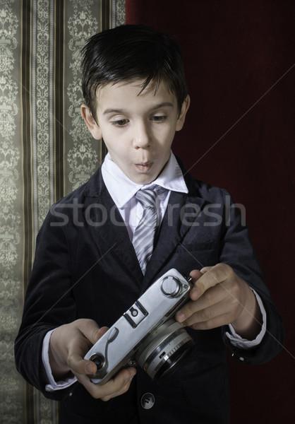 Child taking pictures with vintage camera Stock photo © deyangeorgiev