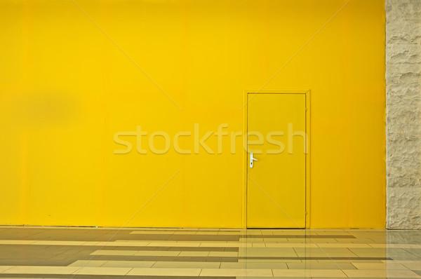 Yellow wall with a door Stock photo © deyangeorgiev
