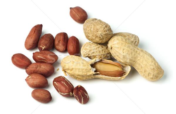 Raw peanuts in shells and shelled peanuts Stock photo © deyangeorgiev