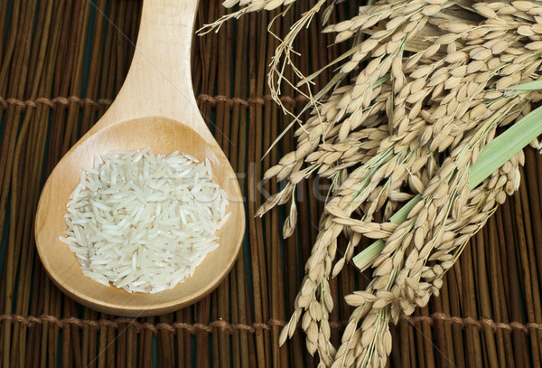 Basmati rice in wooden spoon Stock photo © deyangeorgiev