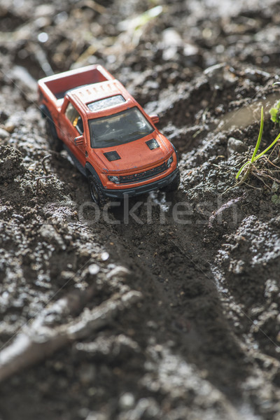 Small red off road car toy in the nature Stock photo © deyangeorgiev