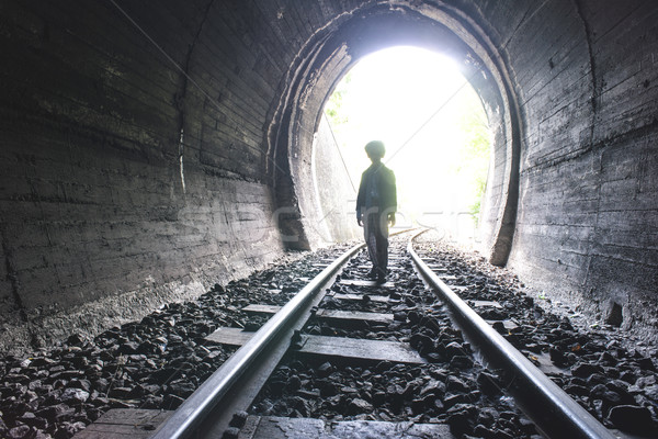Child walking in railway tunnel Stock photo © deyangeorgiev