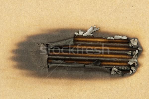 Burned paper and hole Stock photo © deyangeorgiev