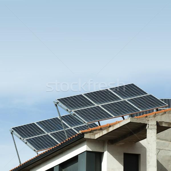 Solar panels on the roof of a building Stock photo © deyangeorgiev
