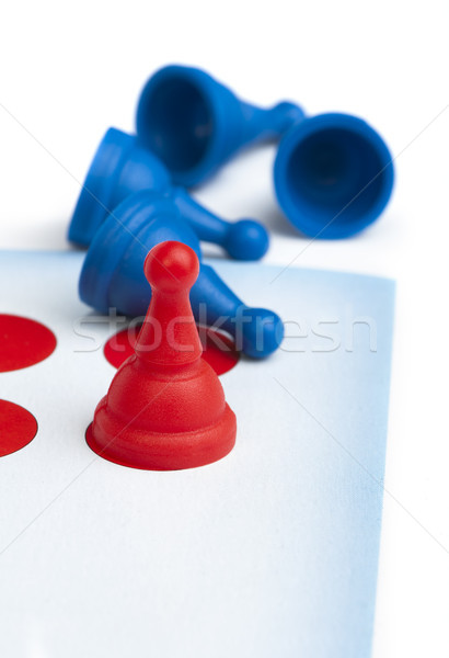 Red and blue game pawns white isolated Stock photo © deyangeorgiev
