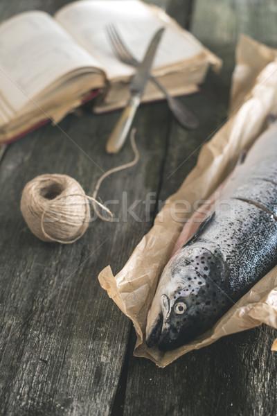 Raw salmon fish on vintage wooden table Stock photo © deyangeorgiev