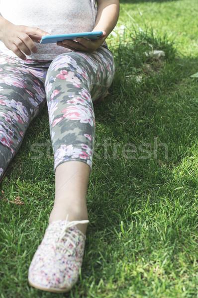 Hamile kadın bahçe çim telefon Stok fotoğraf © deyangeorgiev